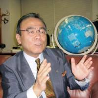 Geos corp. President Tsuneo Kusunoki speaks during a recent interview in St. Petersburg, Russia, about the language-school chain's plans for Russia. | KYODO PHOTO