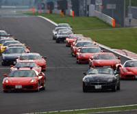 Owners of Maseratis and Ferraris put their cars through their paces at the Fuji Speedway racetrack here during Cornes Festival 2006, an event sponsored by the auto importer of the same name in June.   PHOTO COURTESY OF CORNES and CO.