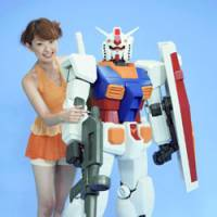 A model shows off a giant Gundam, which will hit the market Dec. 16. | PHOTO COURTESY OF BANDAI CO./KYODO