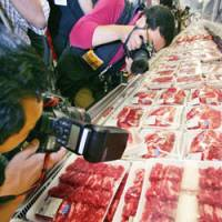 Photographers focus on U.S. beef Wednesday at a store of Costco Japan, the Japanese unit of the U.S. retailer, in Chiba. | AP PHOTO