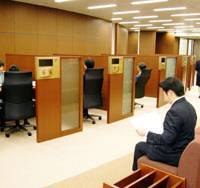 A man waits to talk to a consultant at a Nippon Life Insurance Co. outlet in Tokyo's Marunouchi district. The firm has 46 such offices nationwide.   PHOTO COURTESY OF NIPPON LIFE INSURANCE CO.