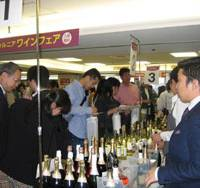 Consumers try out various California wines during a tasting event in a Hanshin department store in Osaka. | KYODO PHOTO
