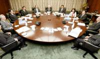 Members of the Bank of Japan's Policy Board meet Wednesday morning at the central bank before deciding to keep its key interest rate unchanged.   KYODO PHOTO