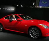 Nissan Motor Co. Chief Operating Officer Toshiyuki Shiga shows off the new Skyline coupe in Tokyo on Tuesday.   AP PHOTO