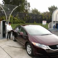 A Clarity, Honda's new fuel-cell vehicle, is refueled at the company's research and development unit in Los Angeles last month, while a peek under its hood is shown below. | HIROKO NAKATA PHOTOS