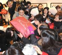 Shoppers scramble to buy 'lucky bags' as the Matsuya department store in Tokyo's Ginza district opens for business for the new year Wednesday morning. More than 6,000 people lined up to purchase the packages, whose contents are not revealed until you buy one.   SATOKO KAWASAKI PHOTO