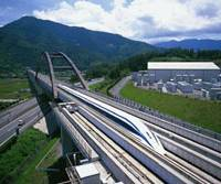 A maglev train runs on a test course in Yamanashi Prefecture. The train's developer, Central Japan Railway Co. (JR Tokai), hopes the high-speed transport will pay off in the future.   CENTRAL JAPAN RAILWAY PHOTO