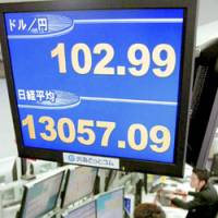 The dollar is quoted at ¥102.99 at 11:17 a.m. Monday at Gaitame.Com Co. in Tokyo. | KYODO PHOTO