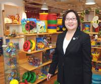 Fun and profit: Bornelund Inc. President Hiroko Nakanishi shows off some of the imported toys available at the company's store in Shibuya Ward, Tokyo, earlier this month. | SATOKO KAWASAKI PHOTO