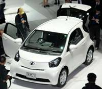 Kicking the tires: Reporters check out Toyota Motor Corp.'s new iQ during a photo session in Makuhari, Chiba Prefecture, on Wednesday. | SATOKO KAWSAKI PHOTO