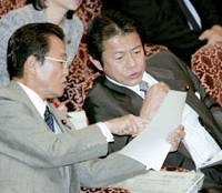Diet matters: Prime Minister Taro Aso (left) and Finance Minister Shoichi Nakagawa talk in the Diet on Oct. 14. | KYODO PHOTO