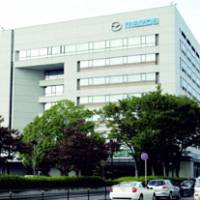 Improving its standing: Hiroshima Prefecture-headquartered Mazda Motor Corp.'s shares held by ailing Ford Motor Co. will be purchased by Hiroshima Bank and other Japanese companies. Ford owns a third of Mazda. | KYODO PHOTO