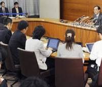 Spreading the news: Bank of Japan Gov. Masaaki Shirakawa briefs reporters Friday in Tokyo about the central bank's credit-easing rate cut earlier in the day. | KYODO PHOTO