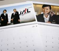 For the memories: This photo shows calendars featuring photographs of Japan Airlines cabin attendants. The once-popular calendars are being discontinued. | KYODO PHOTO