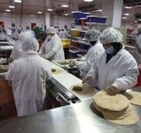 Fresh food the future: Workers prepare fresh food wraps at a recently opened 'green' center on Long Island for 674 7-Eleven stores in New York, New Jersey and Pennsylvania. | KYODO PHOTO