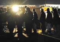 Hooverville, Japan: Homeless people line up for a place to sleep at Hibiya Park in Chiyoda Ward, Tokyo, on Dec. 31. Aid groups set up temporary shelters for temp workers and others out of work. | KYODO PHOTO