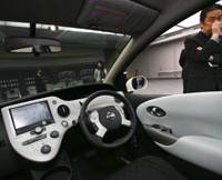 Re-engineering: Nissan Motor Co. Associate Chief Designer Etsuhiro Watanabe stands by the Interior Design Research vehicle BUI-2 on Friday at Nissan Technical Center in Atsugi, Kanagawa Prefecture. | AP PHOTO