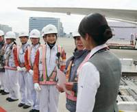 Working hard: Female mechanics at Japan Airlines gather for a meeting Tuesday before preparations for a special Hina Matsuri flight at Haneda airport in Tokyo.   KYODO PHOTO