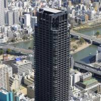 Location, location, location: Work on Japan's tallest condominium building was finished Tuesday in Chuo Ward, Osaka, with nearly all of the units already sold.   KYODO PHOTO