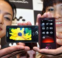 New on the block: Models show off Sony Corp.'s new Walkman X digital music players at a news conference Tuesday at the Sony Building showroom in Tokyo. | AP PHOTO