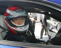 No back-seat driver: Incoming Toyota Motor Corp. President Akio Toyoda sits behind the wheel of a Lexus for a test drive on the Fuji Speedway Formula One racing course in Oyama, Shizuoka Prefecture, in October 2007.   AP PHOTO