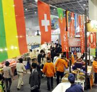Food galore: People walk by food booths from various parts of the world at the 11-day food fair that kicked off Thursday at the Intex Osaka exhibition hall in Suminoe Ward, Osaka.   KYODO PHOTO