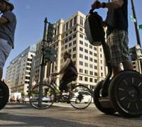 Sales spree: Tourists ride the Segway two-wheeled electric transporter in Washington last year. Segway's Japan unit aims to expand sales to over 1,000 units by the end of March 2012. | AP PHOTO