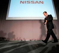 In the race: Nissan Motor Co. chief Carlos Ghosn leaves a news conference on May 12. | AP PHOTO
