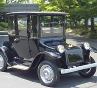 Shocking: An electric car that was imported from the United States in 1917 is displayed Wednesday in Kyoto. | KYODO PHOTO