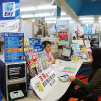 Bits and bytes: A travel agency in Naha, Okinawa Prefecture, has readers for accepting Edy, a type of electronic currency. | KYODO PHOTO