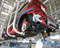 On the move: A worker tightens a bolt on a Maruti Swift diesel car at the Maruti Udyog Ltd. factory in Manesar, 50 km south of New Delhi, in February 2007. The Indian unit of Suzuki Motor Corp. was later renamed Maruti Suzuki India Ltd. | AP PHOTO