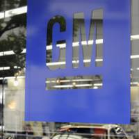 On sale: GM cars are displayed at a dealership in Minato Ward, Tokyo, on Monday. | KYODO PHOTOS