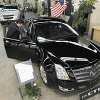 Caddy corner: A man checks out a Cadillac CTS at a General Motors dealership in Minato Ward, Tokyo, on Monday.