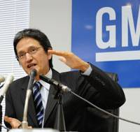 Still here: Rick Brown, president of the Japan unit of General Motors Corp., speaks to reporters Tuesday in Tokyo. | KYODO PHOTO