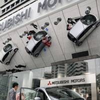 Electrifying debut: Mitsubishi Motors Corp. displays the i-MiEV electric vehicle Friday outside the first-floor showroom at its headquarters in Minato Ward, Tokyo. | SATOKO KAWSAKI PHOTO
