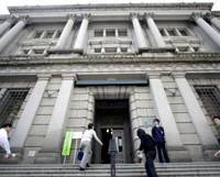 Looking up?: The Bank of Japan's quarterly survey of business sentiment, released Wednesday, shows signs of slight improvement amid continuing gloom. | AP PHOTO