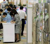 Point-of-sale: Customers fill in application forms Wednesday for the government's Eco-point program at an electronics store in Narashino, Chiba Prefecture. | KYODO PHOTO