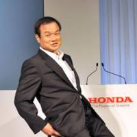 Not so easy rider: Honda Motor Co. President Takanobu Ito tests the U3-X electric unicycle at a news conference in Tokyo on Thursday. | YOSHIAKI MIURA PHOTO