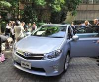 Sai of relief?: Reporters check out Toyota Motor Corp.'s new Sai hybrid sedan during a preview in Tokyo on Tuesday. | YOSHIAKI MIURA PHOTO