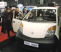 Outsize appeal: A Nano subcompact, Indian automaker Tata Motors Ltd.'s ultralow-price car, attracts attention at the Fukuoka Motor Show on Friday. | KYODO PHOTO