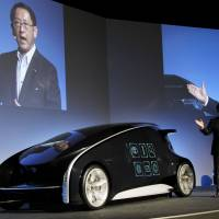Thin end of the wedge: Toyota Motor Corp. President Akio Toyoda introduces the Fun-Vii concept vehicle Monday ahead of the Tokyo Motor Show, which runs Saturday to Dec. 11.   AP