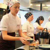 'Udon' stroganoff: Russian employees prepare udon dishes at a media preview Wednesday to promote the Japanese noodle chain Marugame Seimen's inaugural outlet in Moscow. | KYODO