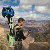 Getting the big picture: Google Maps product manager Ryan Falor uses an Android device to control the Trekker, a backpack with a camera system on top, to traverse the Grand Canyon in Arizona. Google Maps opened a virtual path to the wonders of the Grand Canyon on Jan. 31 by adding panoramic images gathered by hikers using such devices. | AFP-JIJI