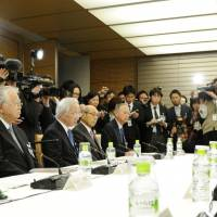 Abe asks business leaders to raise wages to help beat chronic deflation