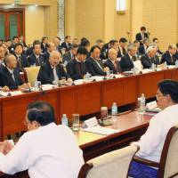 Risk averse?: A major Japanese corporate delegation led by Hiromasa Yonekura, chairman of the Keidanren business lobby, meets with Myanmar officials during their Feb. 6 visit to Naypyitaw. | KYODO