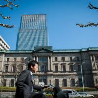 BOJ stands pat on monetary easing, ups assessment