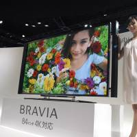 Bigger and better: Sony Corp. displays its 84-inch 4K TV at CEATEC in Makuhari Messe, Chiba, last October. | KAZUAKI NAGATA