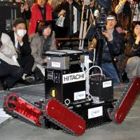 On track: The Tsubaki robot, developed by a startup firm of Chiba Institute of Technology, goes through its motions Wednesday in Narashino, Chiba Prefecture.   YOSHIAKI MIURA