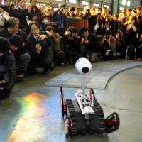 Hold it, there's more: The Sakura robot, equipped with camera and thermal imager, is put through its paces in front of the media Wednesday in Narashino, Chiba Prefecture. | YOSHIAKI MIURA
