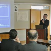 Power plug: An official from trading house Marubeni Corp. briefs local officials about plans to start geothermal power generation Tuesday in the town of Kamikawa, Hokkaido. | KYODO